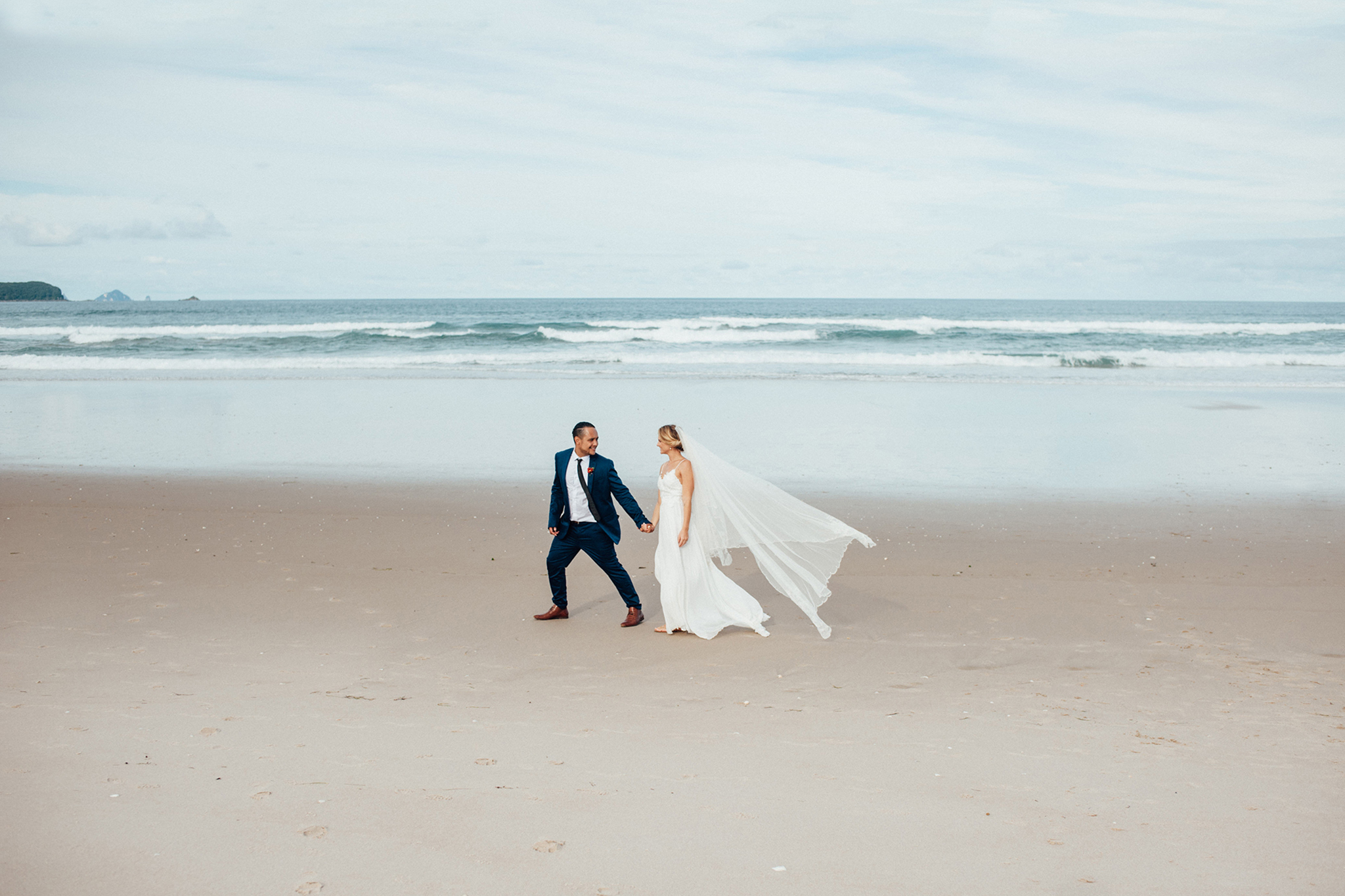 Wedding photography opoutere bride and groom beach adventure