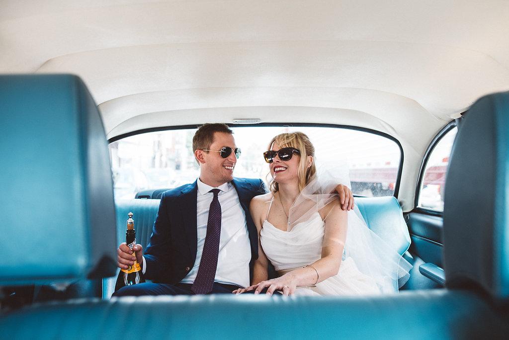 Molly + Matt Back Of Taxi