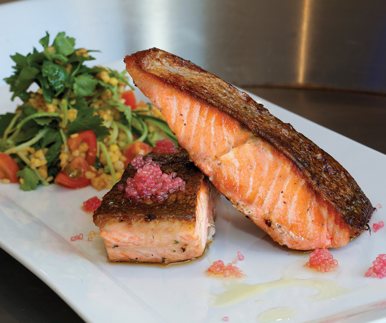 Pan-fried salmon and finger limes