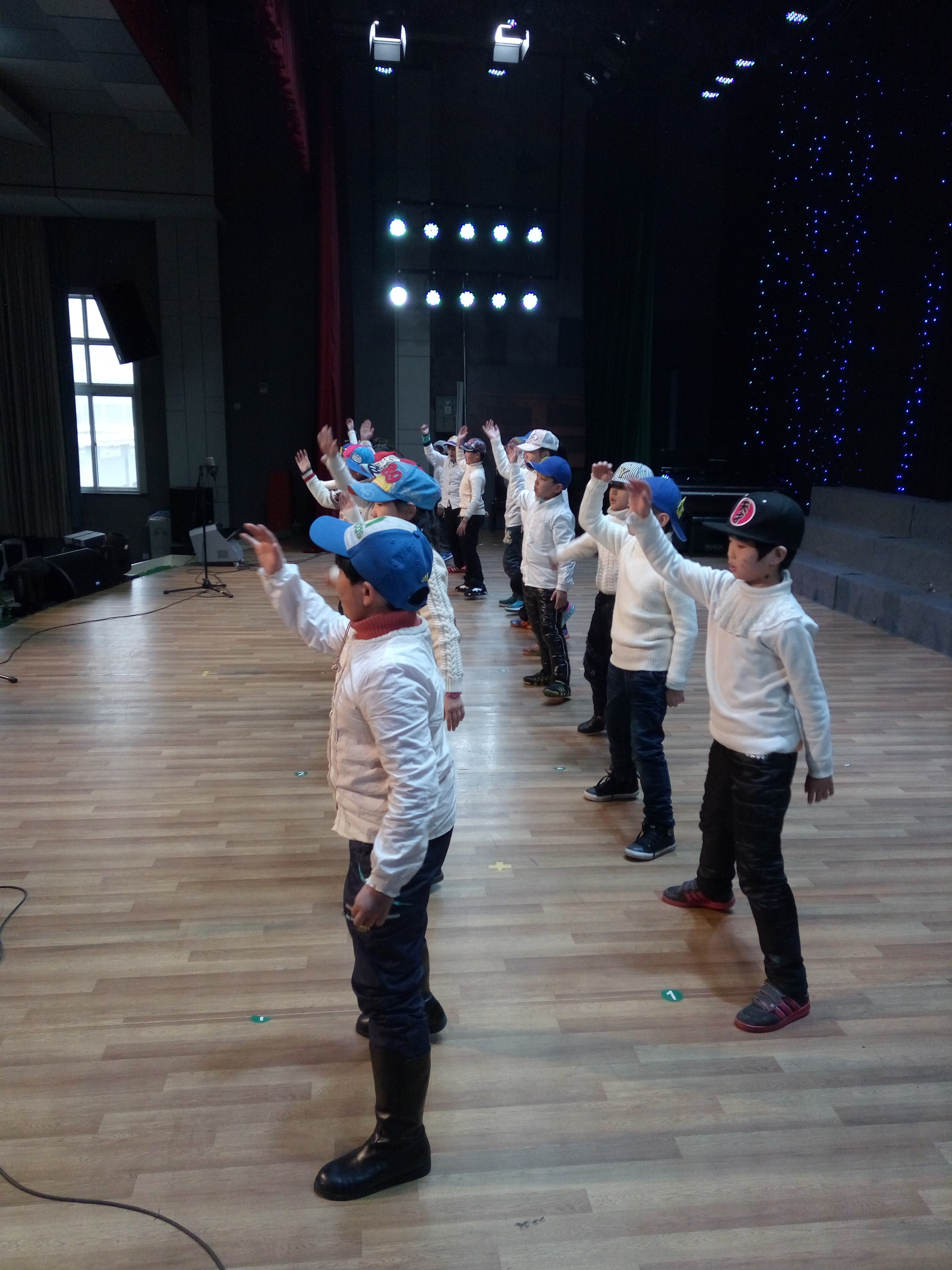 """My third grade English club briefly became NSYNC to sing and dance to """"We Will Rock You"""" for the school's Christmas festival."""