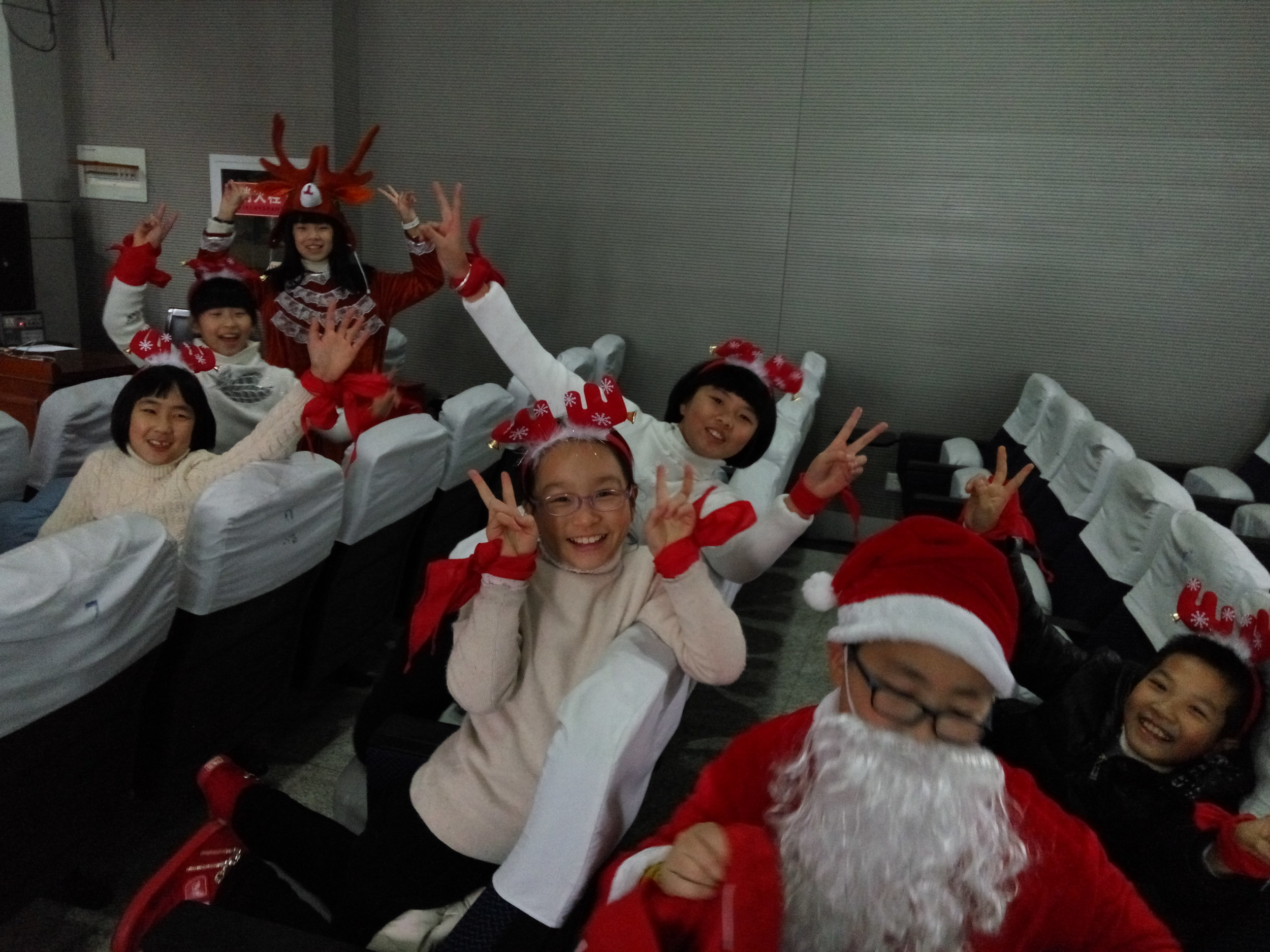 This is my fifth grade English club just before going on to give a Christmas show we rehearsed.