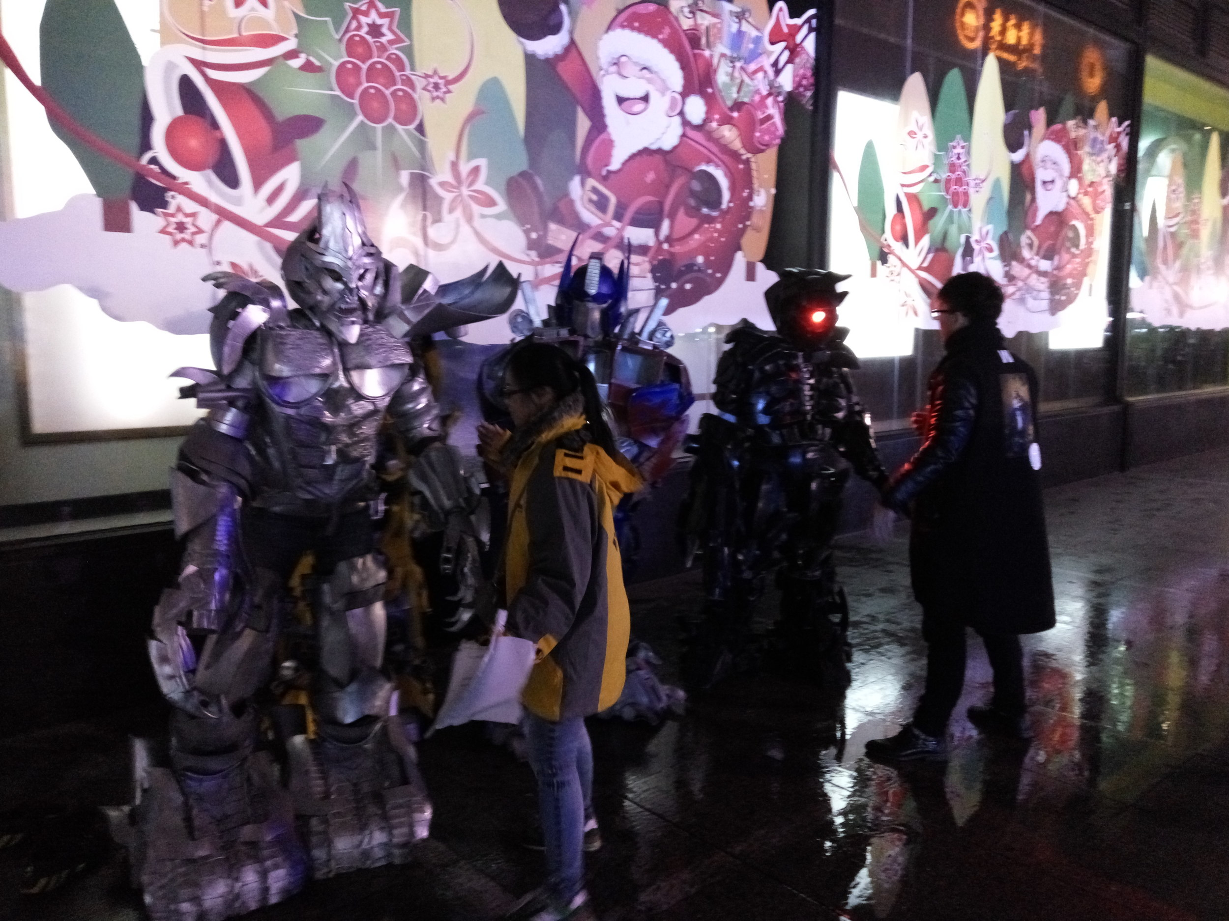 The Transformers get instructions from their directors before going out to greet the public.