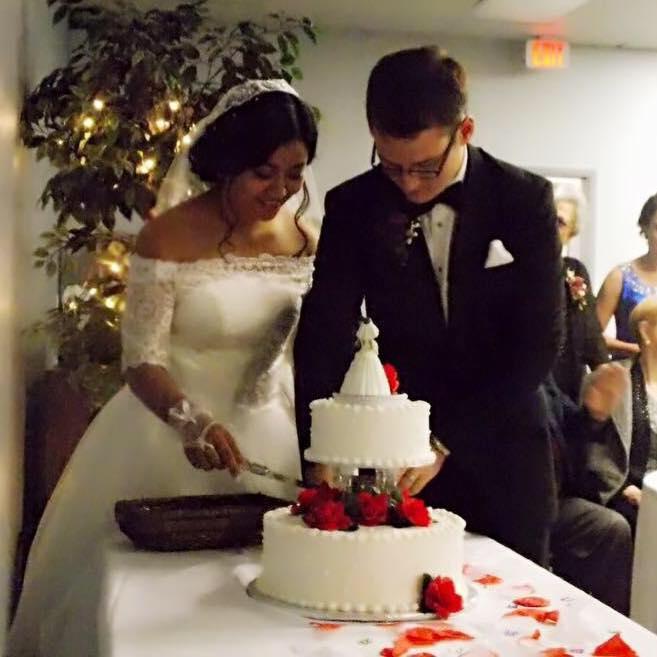 Seth and his bride cut the cake. C/o Seth.