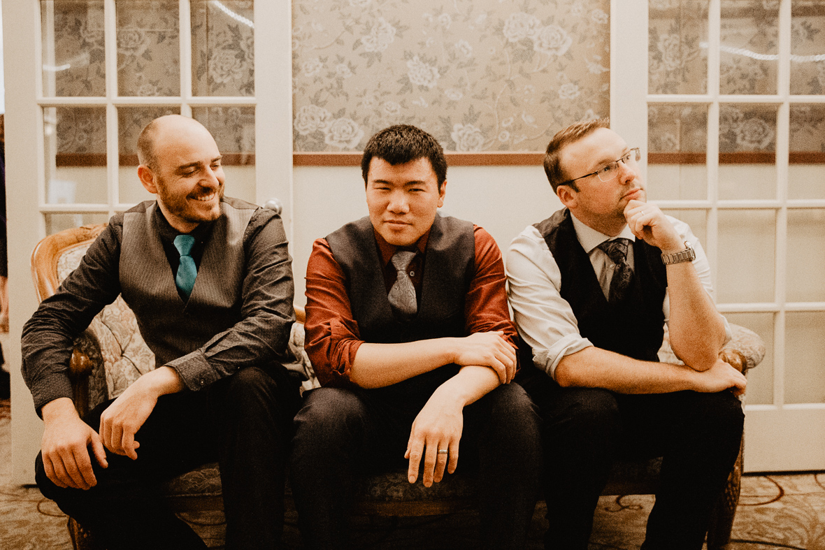 sitting down wedding band photo.jpg