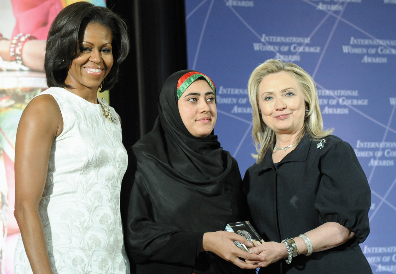 Secretary Clinton wearing an unidentified rectangular watch next to first lady michelle obama and maryam durani. photo courtesy of the u.s. state department.
