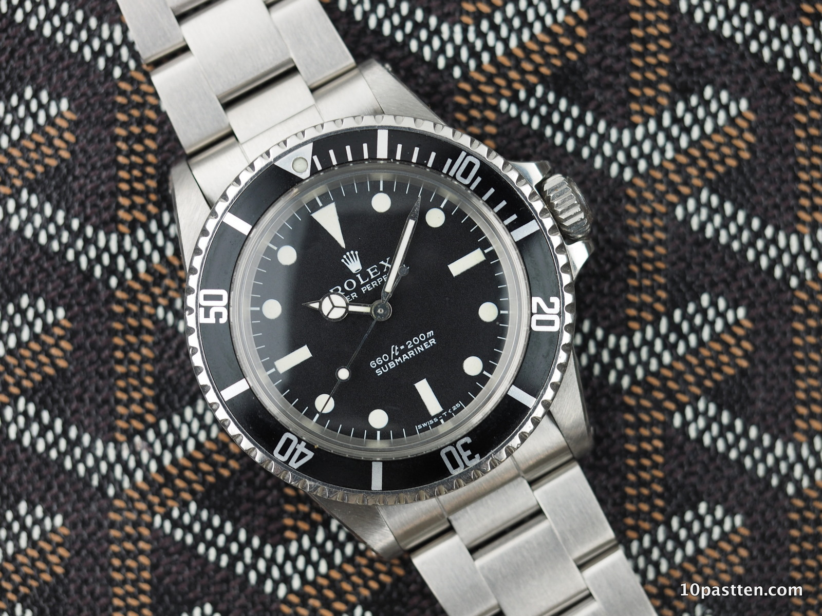 Is this Ref. 5513 the same as the Ref. 114060?No, but the retail price of these similar watches couldn't be further apart.