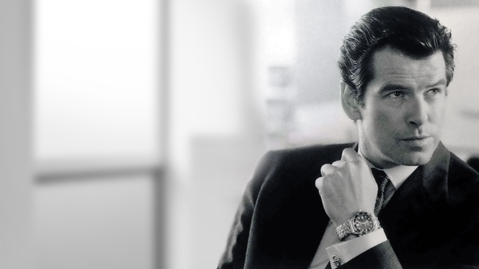 Pierce Brosnan as James Bond in  Tomorrow Never Dies  promotional images.