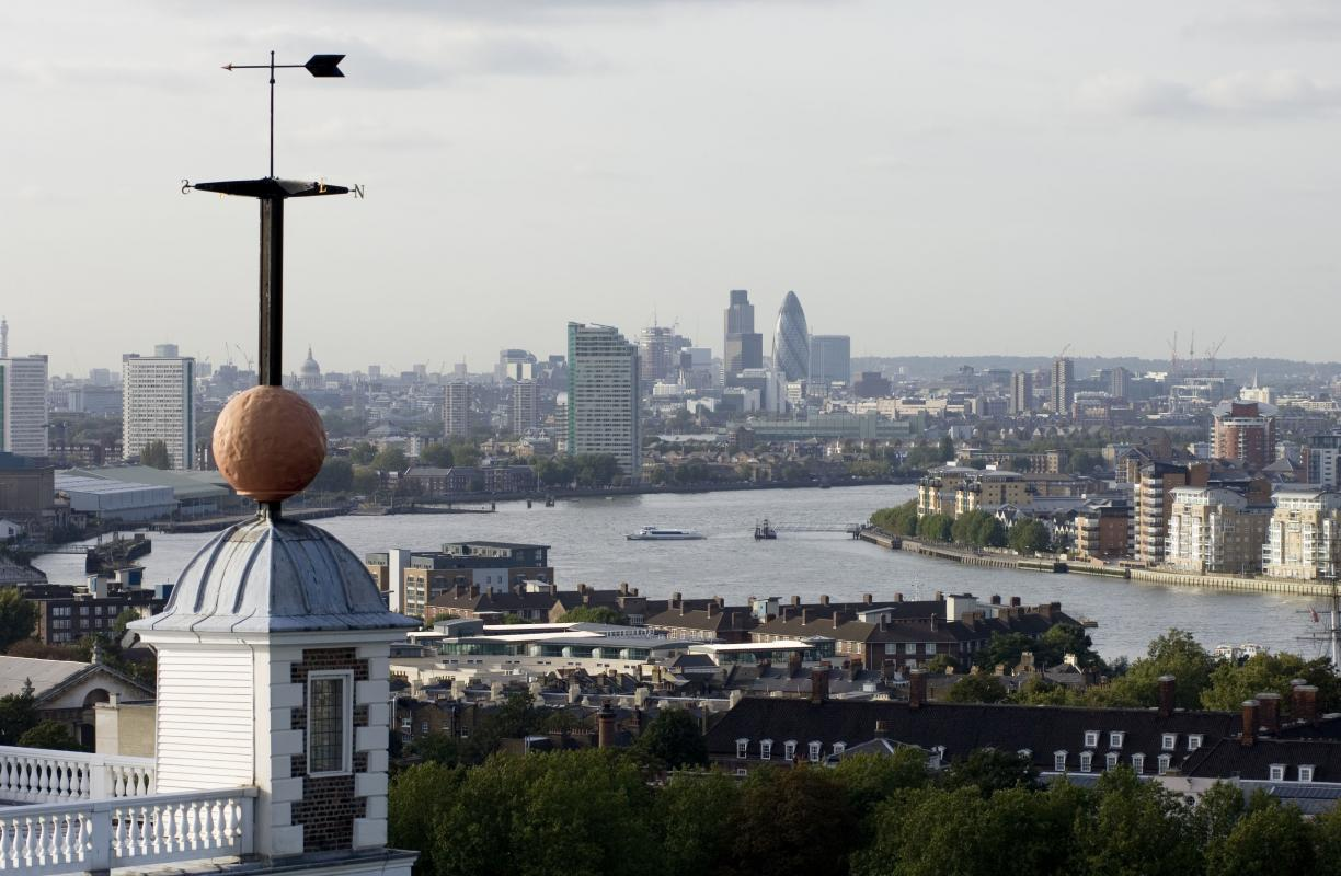 The time ball at Royal Observatory Greenwich with a view of the City and the River Thames.