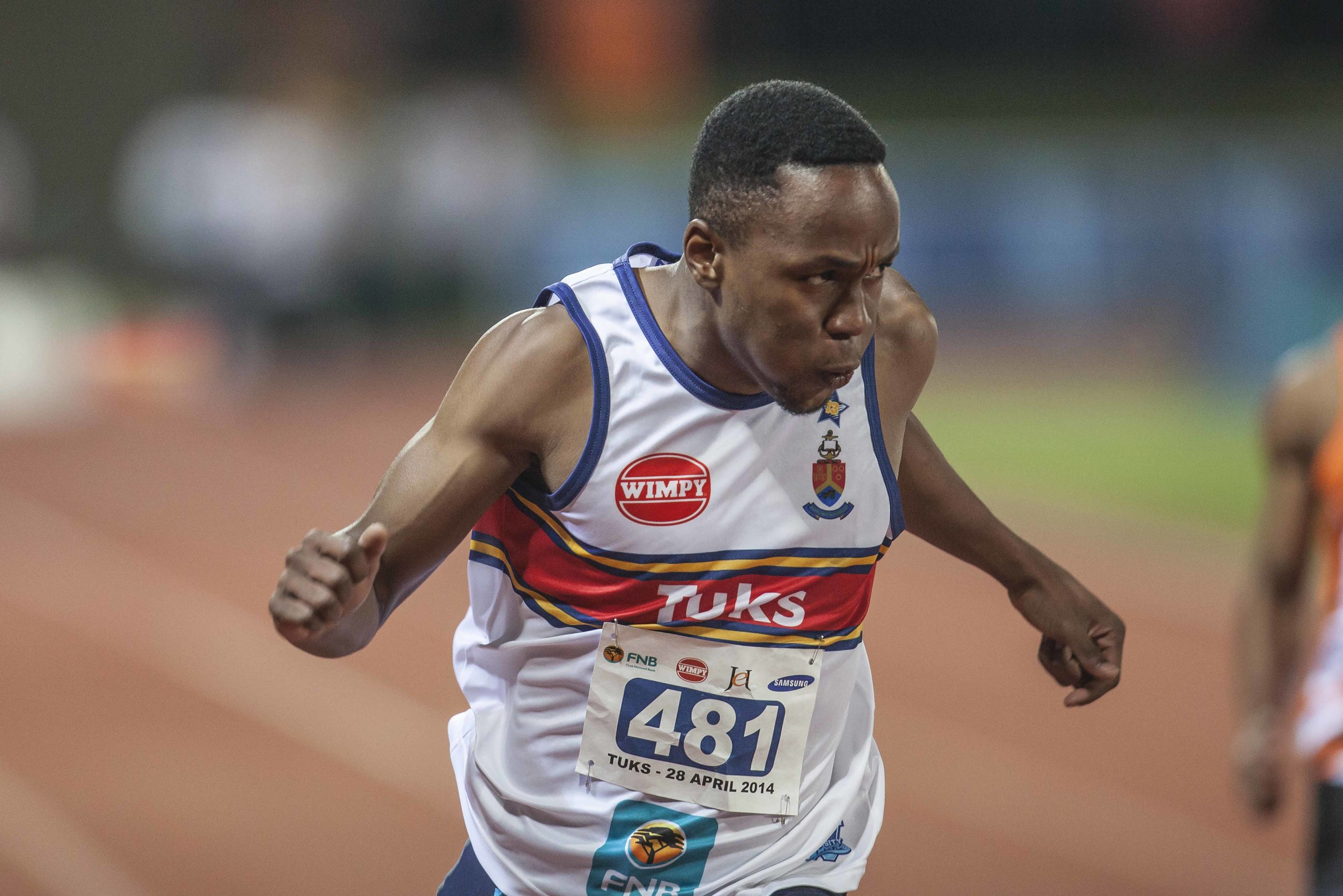 Akani Simbine crosses the line for Tuks. The athletics program at Tuks is one of the best in the country. Their athletes have won both Varsity Athletics and USSA for two consecutive years. Image supplied by Tuks Sport.