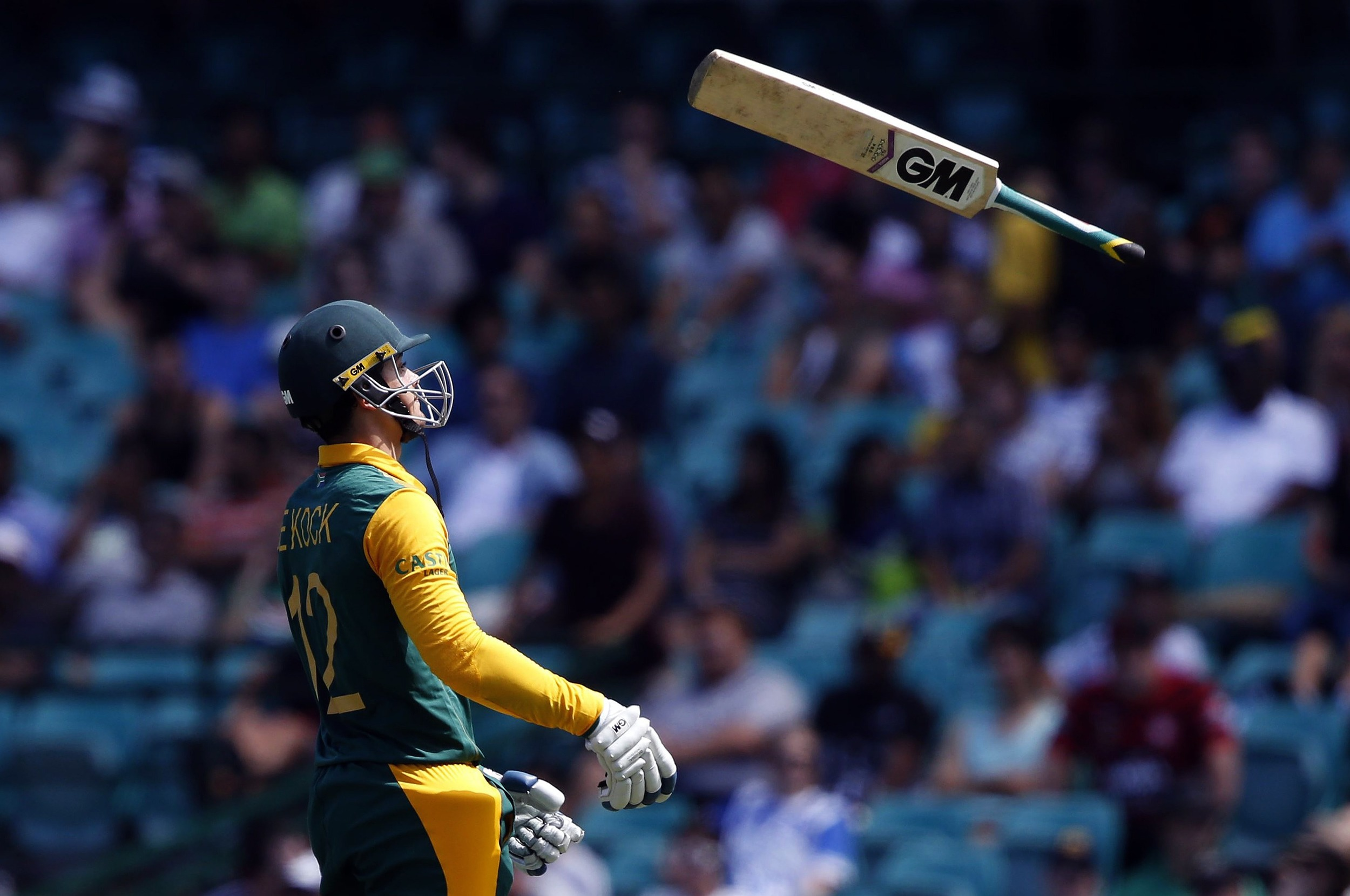 Quinton de Kock throws his bat as he walks off the field after being dismissed by West Indies bowler Jason Holder for twelve runs during the Cricket World Cup match at the Sydney Cricket Ground (SCG). Image suplied by Action Images/ Jason Reed.