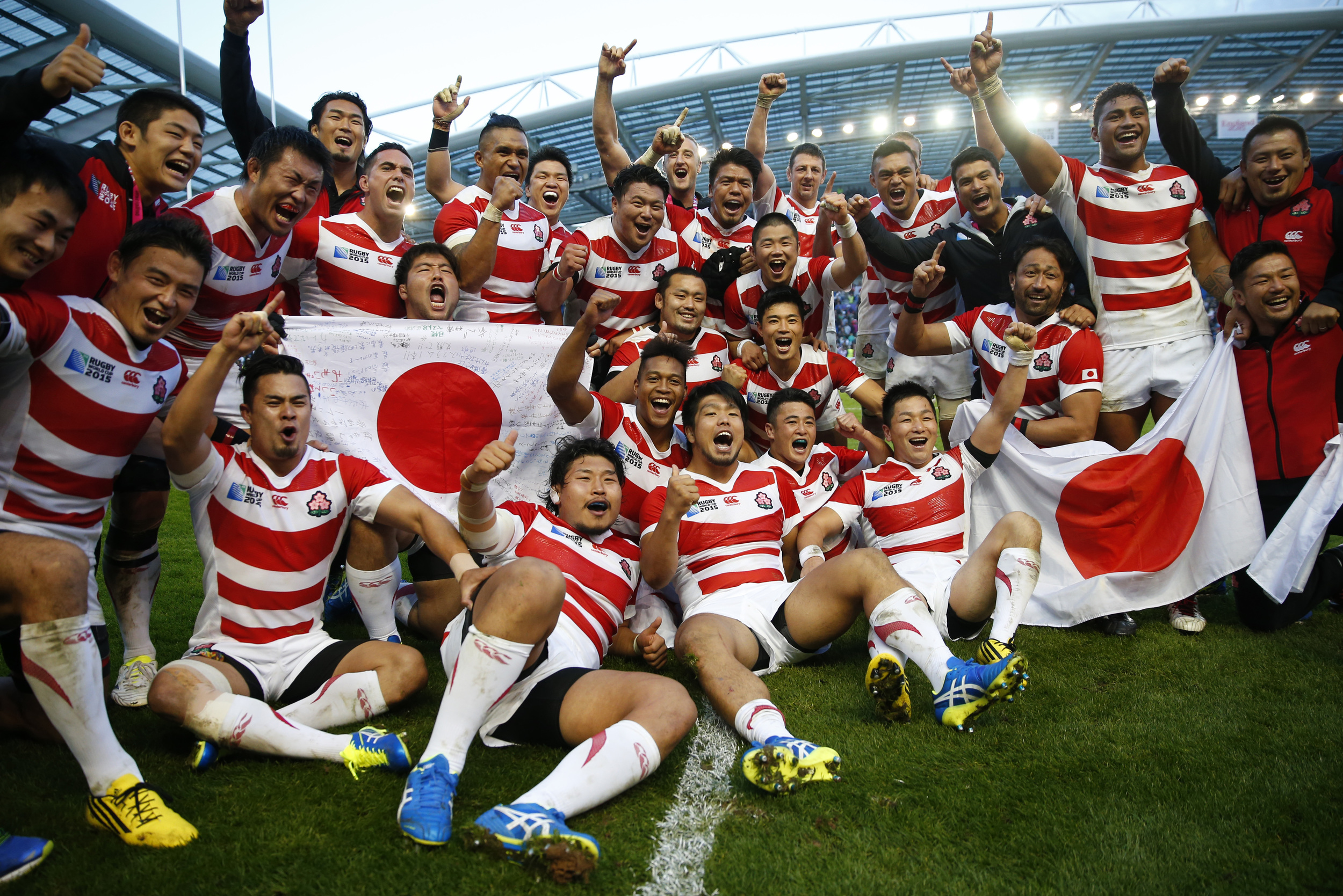 Japan celebrate one of the famous upsets in sport's history after they beat South Africa 34-32 in their opening game at the 2015 Rugby World Cup in Brighton, England. Image supplied by Action Images/Eddie Keogh