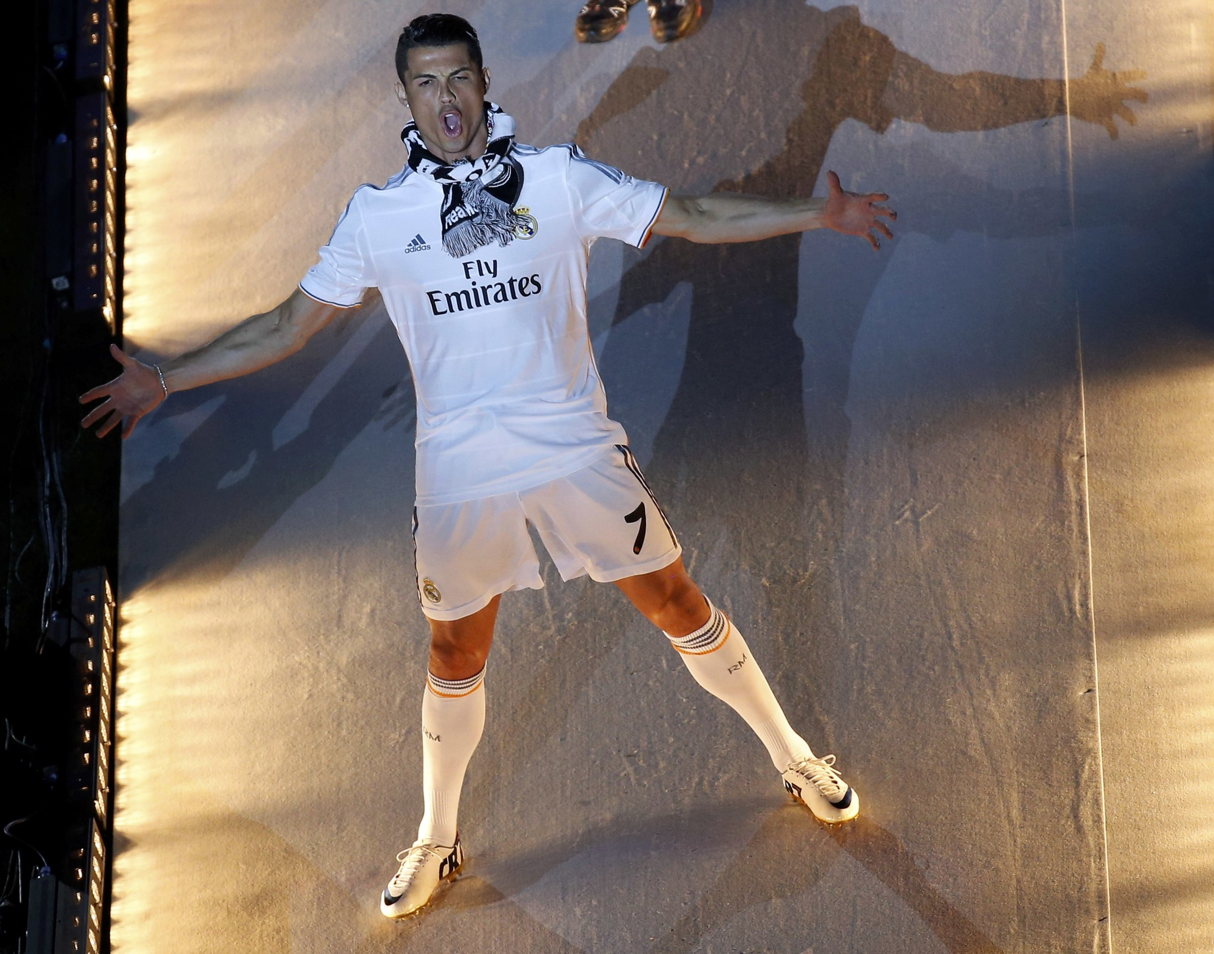 Real Madrid's Cristiano Ronaldo reacts a he arrives at Santiago Bernabeu stadium during a victory ceremony in Madrid after their 2014 Champions League victory against neighbours Atletico Madrid. Ronaldo has been labelled as arrogant by many but his individual and team awards back his egotistical remarks. Image supplied by Action Images /Paul Hanna