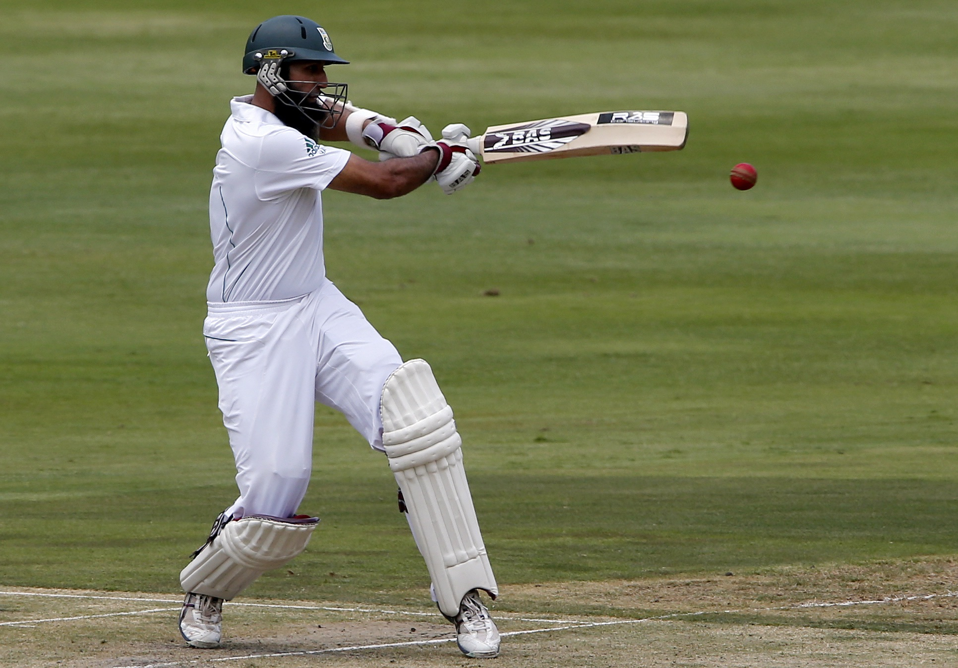 Image supplied by Actions Images/ Mike Hutchings.  Hashim Amla, South Africa's Test cricket captain, pulls a short ball against Pakistan in the first Test in Johannesburg, in 2013.  Image supplied by Actions Images/ Mike Hutchings.
