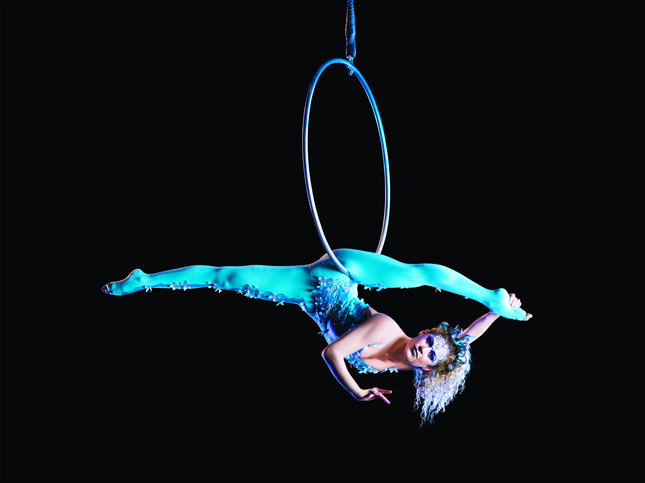 An acrobat performs for Cirque du Soleil, suspended on a cerceau. When gymnasts retire from competition, often at a young age, Cirque offers a continuation of a passion. Image supplied by Cirque du Soleil.
