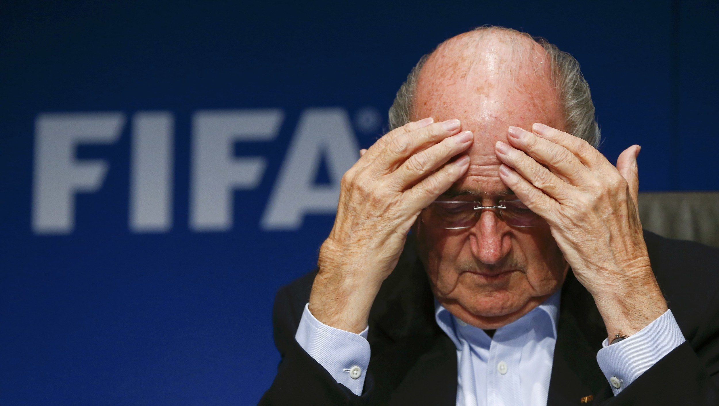 Suspended president of FIFA, Sepp Blatter, looks dejected as he faces journalists at a news conference in September 2014. The disgraced Swiss is facing a life ban from football after a series of corruption allegations, most notably,money laundering related to the allocation of the 2018 and 2022 FIFA soccer World Cups in Russia and Qatar. Image supplied by Action Images / Arnd Wiegmann.