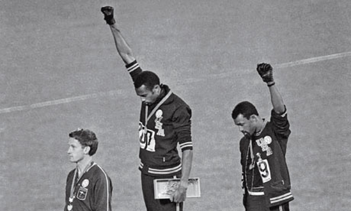 At the 1968 Olympic Games in Mexico City, John Carlos (right), Tommie Smith (centre) and Peter Norman, who wore an Olympic Project for Human Rights badge in support of their gesture.