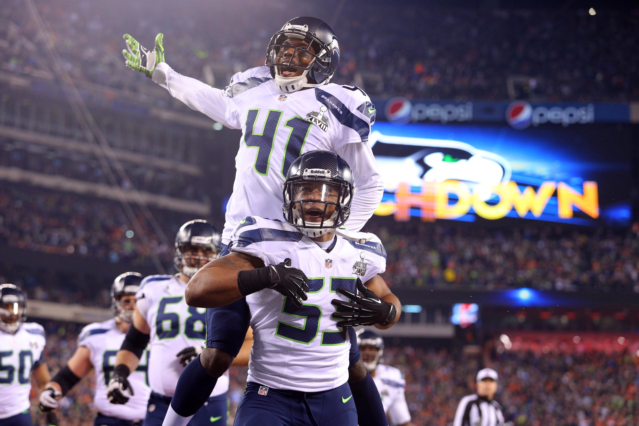 Seattle Seahawks players celebrate a touchdown infront of another sell-out crowd. The franchise is unrivalled in the NFL when it comes to fan engagement and has translated passionate support into on-field success. Image supplied by Action Images.