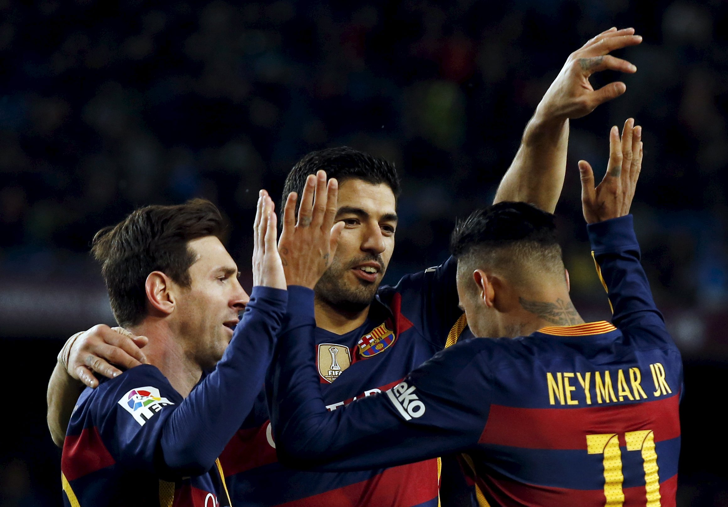 Barcelona's three South American superstars Lionel Messi, Luis Suarez and Neymar Jr (from l to r) celebrate a goal against Celta Vigo. The Catalan giants romped to a 6-1 victory. Image supplied by Action Images /Albert Gea.
