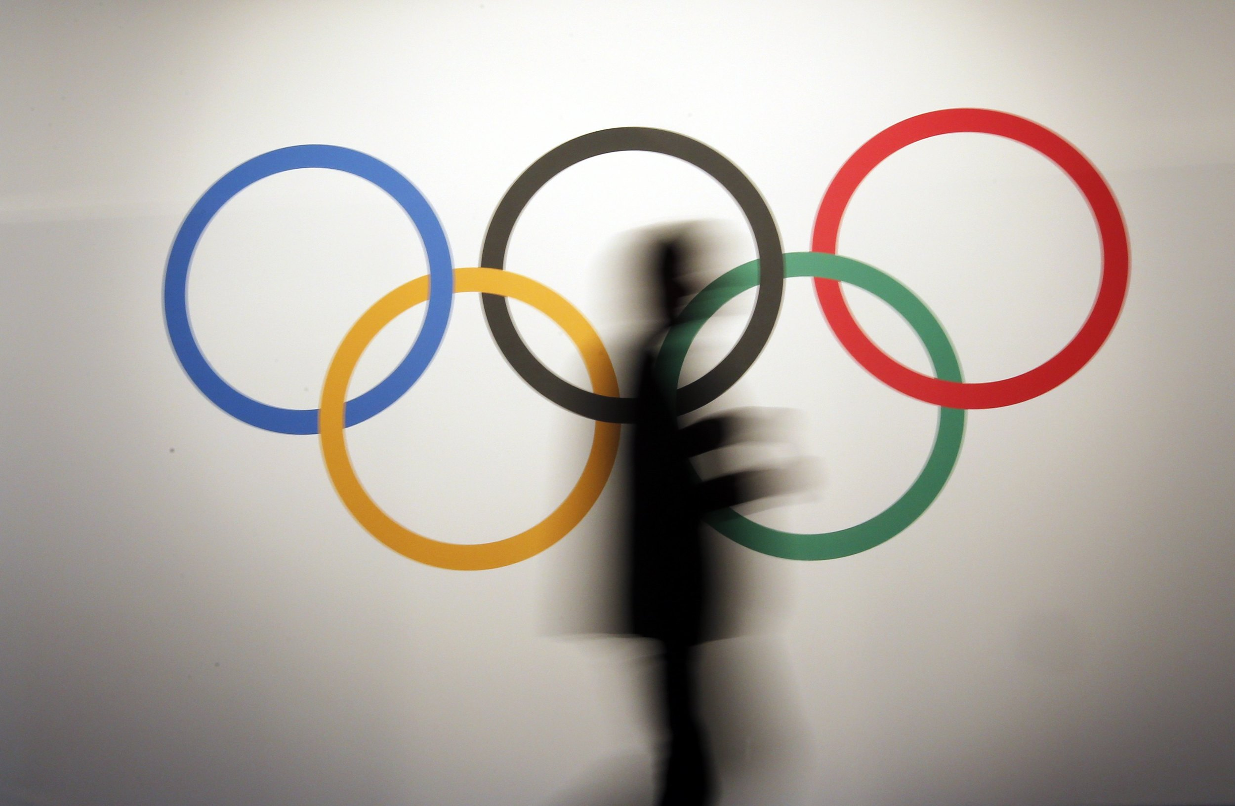 A man walks past the 5 Olympic Rings. These rings, representing the 5 continents of the world, will be the symbol that Team Refugee Olympic Athletes will walk behind during the Games in Rio later this year. Image supplied by Action Images