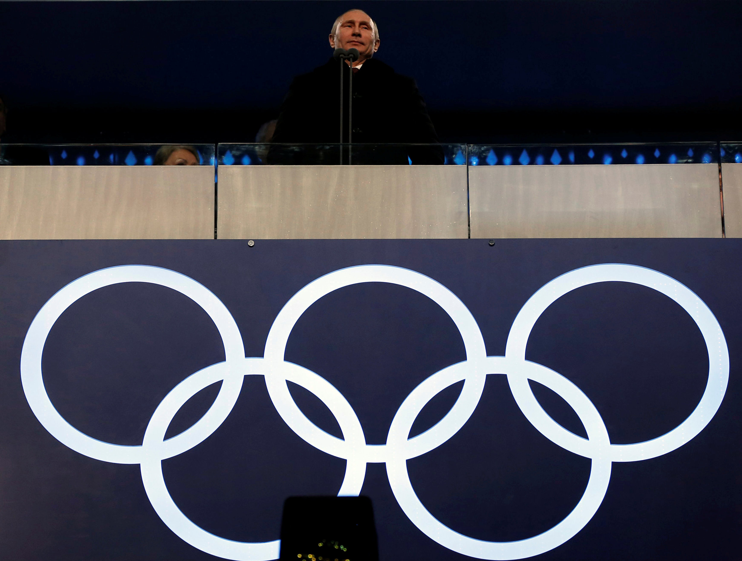 Russian President Vladimir Putin stands during the opening ceremony of the 2014 Sochi Winter Olympics. Putin's government views sport as not only a tool to help build nationallism, but as a weapon to dominate on the world stage. Image supplied by CONQA Sport / Phil Noble.