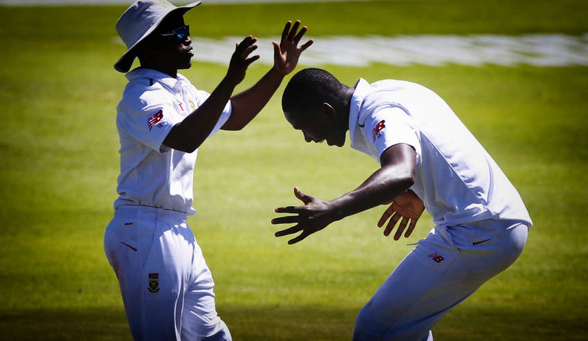South Africa's Temba Bavuma (left) and Kagiso Rabada celebrate the wicket of England's Nick Compton (not in picture) during the second cricket test match in Cape Town, South Africa, January 2, 2016.  REUTERS / Mike Hutchings