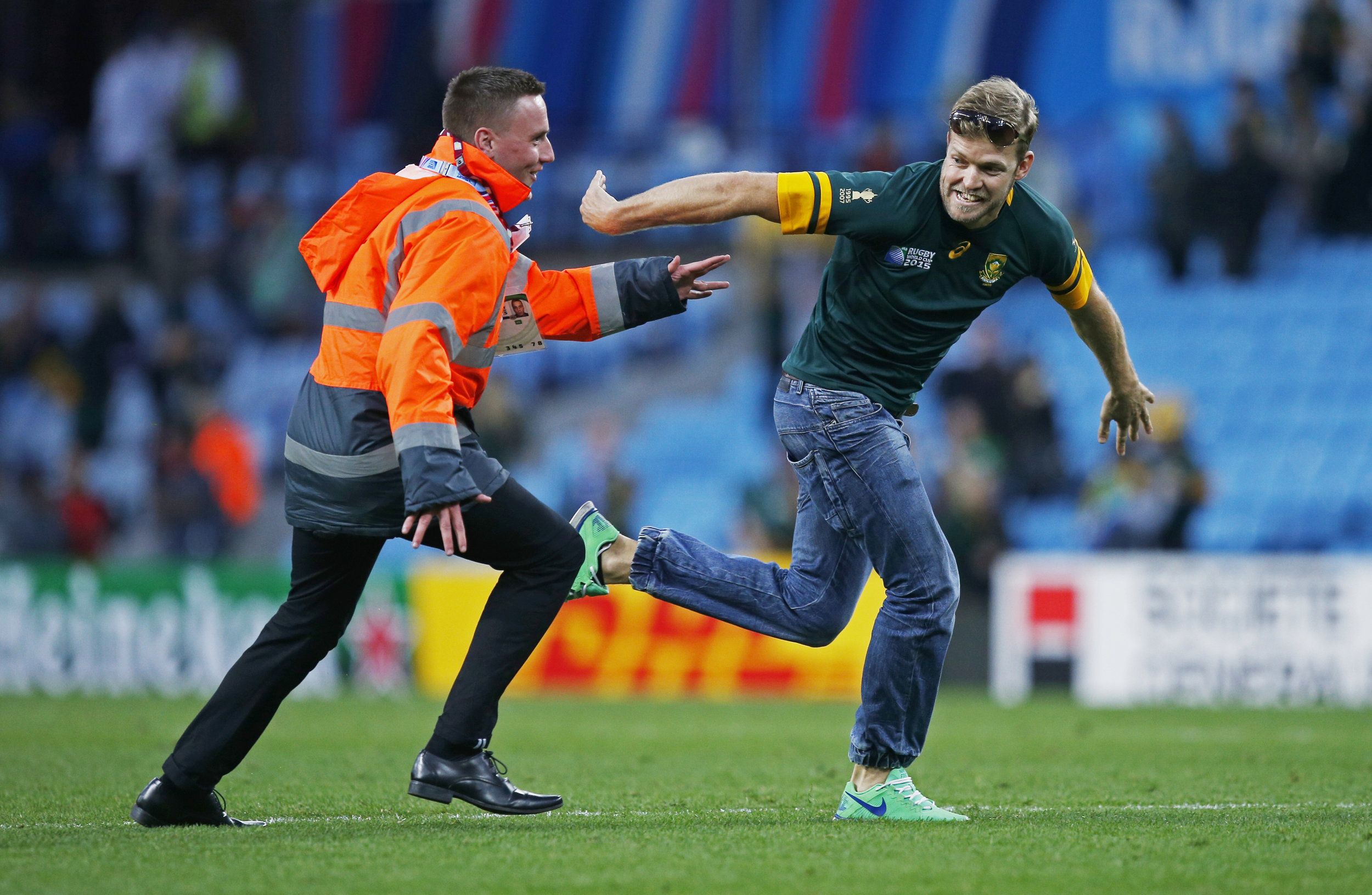 A South African rugby fan invades the pitch during his nation's 2015 World Cup clash with Samoa at Villa Park, Birmingham England.  Image supplied by Action Images / Peter Cziborra.