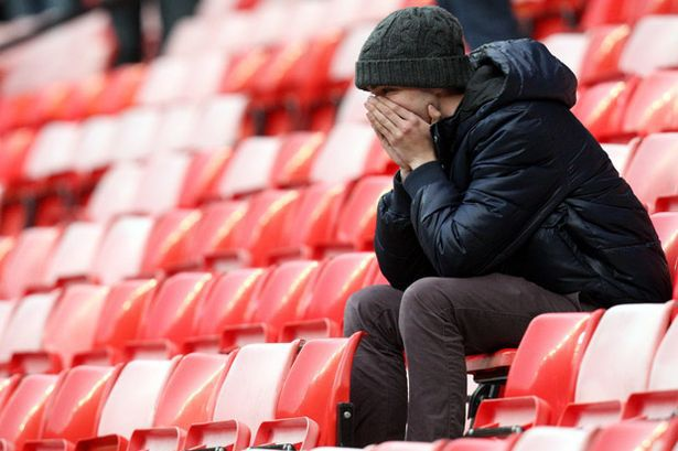 A Manchester United fan looks on with disbelief after his side lost 2-1 to AFC Bournemouth at home last season.