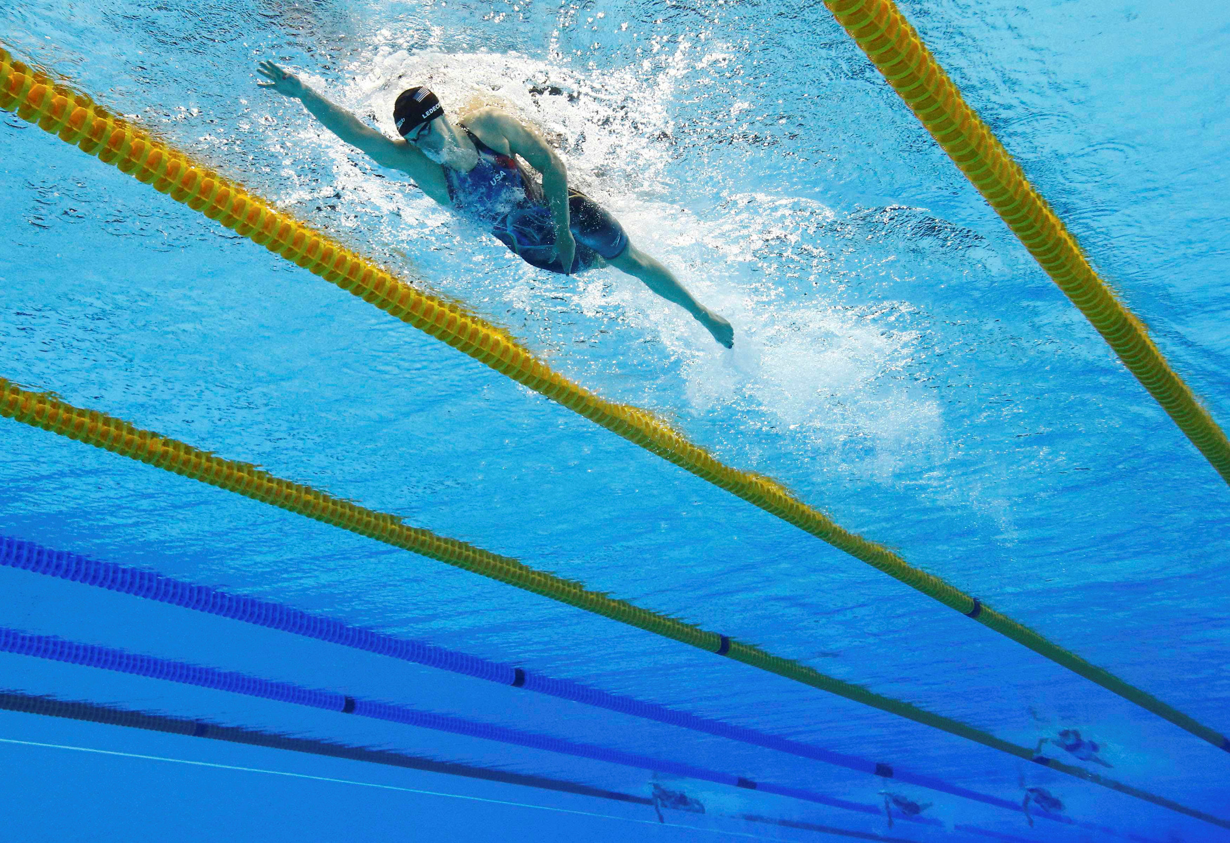 Katie Ledecky of USA Swimming steams ahead of the competition in the women's 800m freestyle final at the Olympic Aquatics Stadium in Rio de Janeiro. As this photo demonstrates, the gulf between the USA and the rest of the competition is vast. Image supplied by Action Images / Stefan Wermuth.