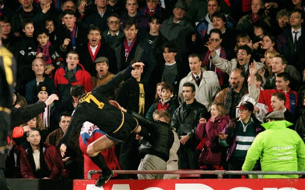 Eric Cantona (7) flies foot first into the chest of Crystal Palace supporter, Matthew Simmons after being sent off in Manchester United's Premier League clash at Selhurst Park in 1995.