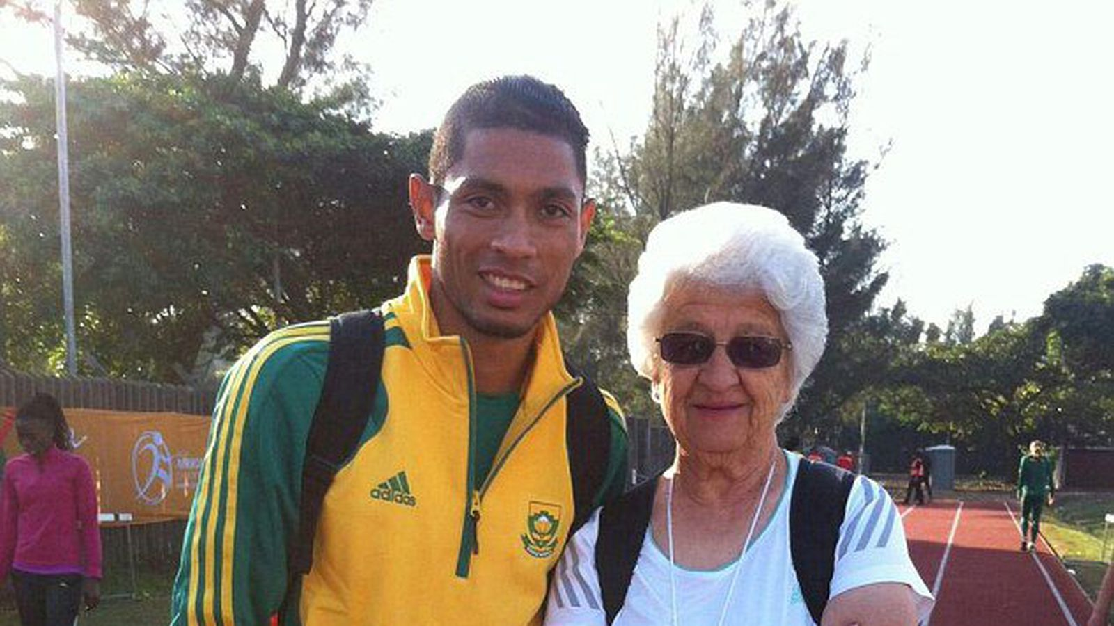 """Wayde van Niekerk (l) and Anna """"Tannie Ans"""" Botha (r) have formed a remarkable relationship, both professionally and personally, that has catapulted the young sprinter to athletics royalty."""
