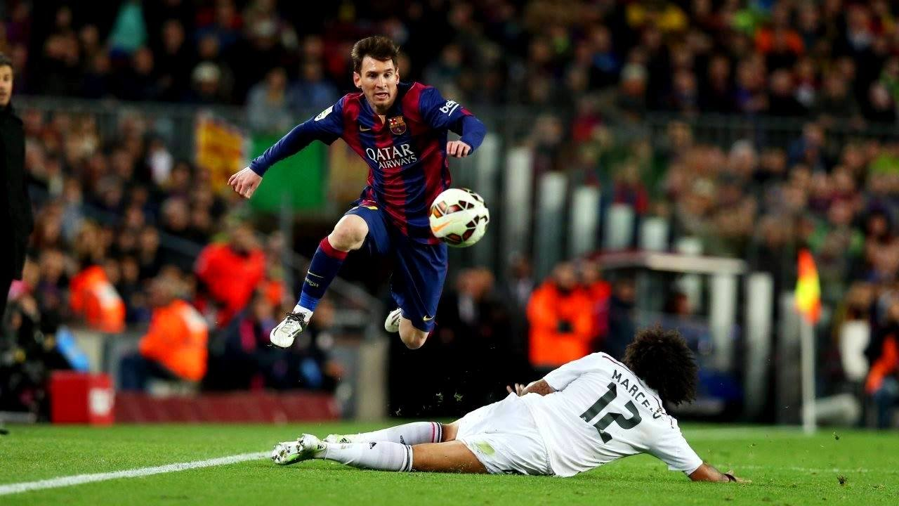 Lionel Messi, arguably the greatest footballer who has ever lived, hurdles a slide tackle as he makes his way up the field. His ability to manoeuvre his body has helped compensate for his dimunutive frame.