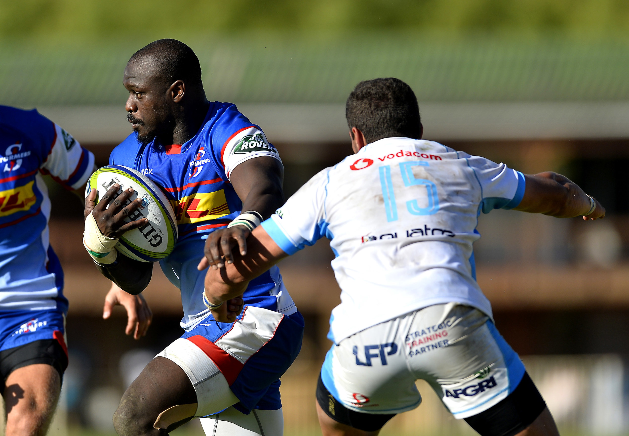 Raymond Rhule busts a tackle for his new side, the Stormers, in a Super Rugby warm up match against the Bulls.