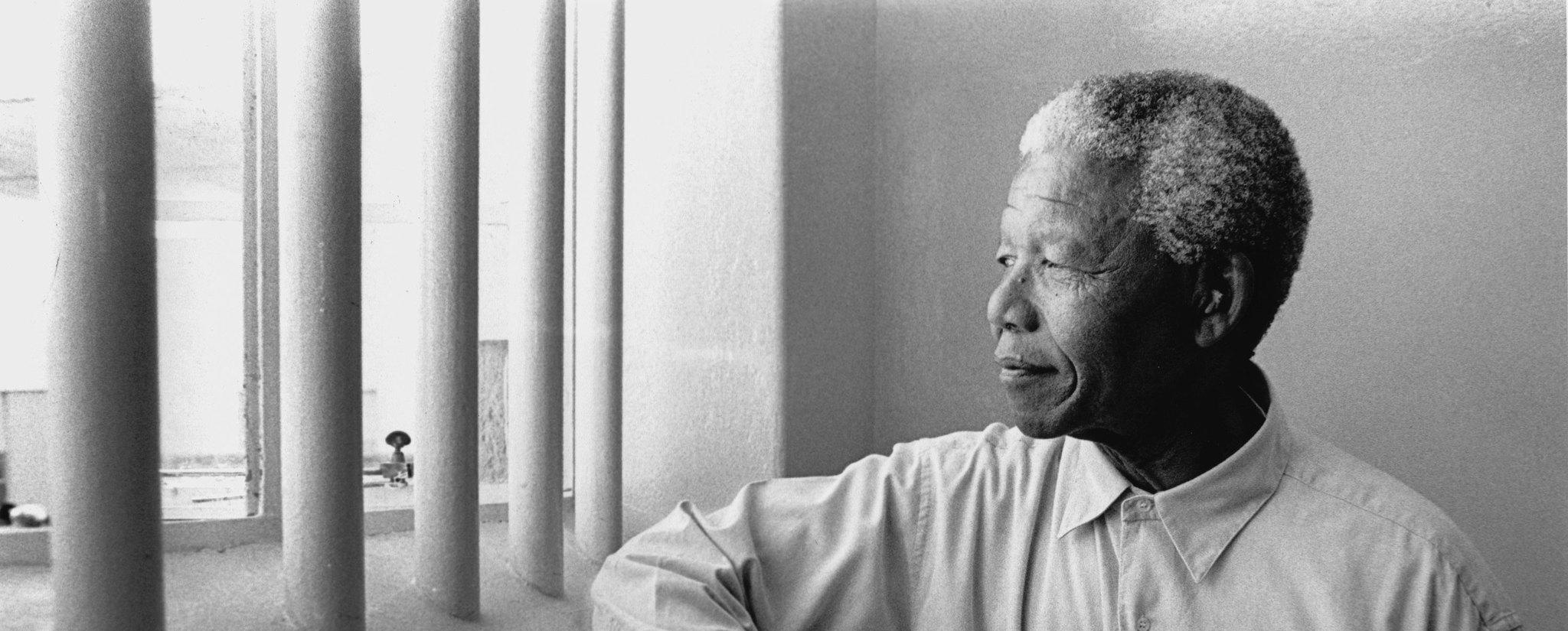 South Africa's first black President Nelson Mandela revisits his prison cell on Robben Island in 1994.  (Jurgen Schadeberg / Getty Images)