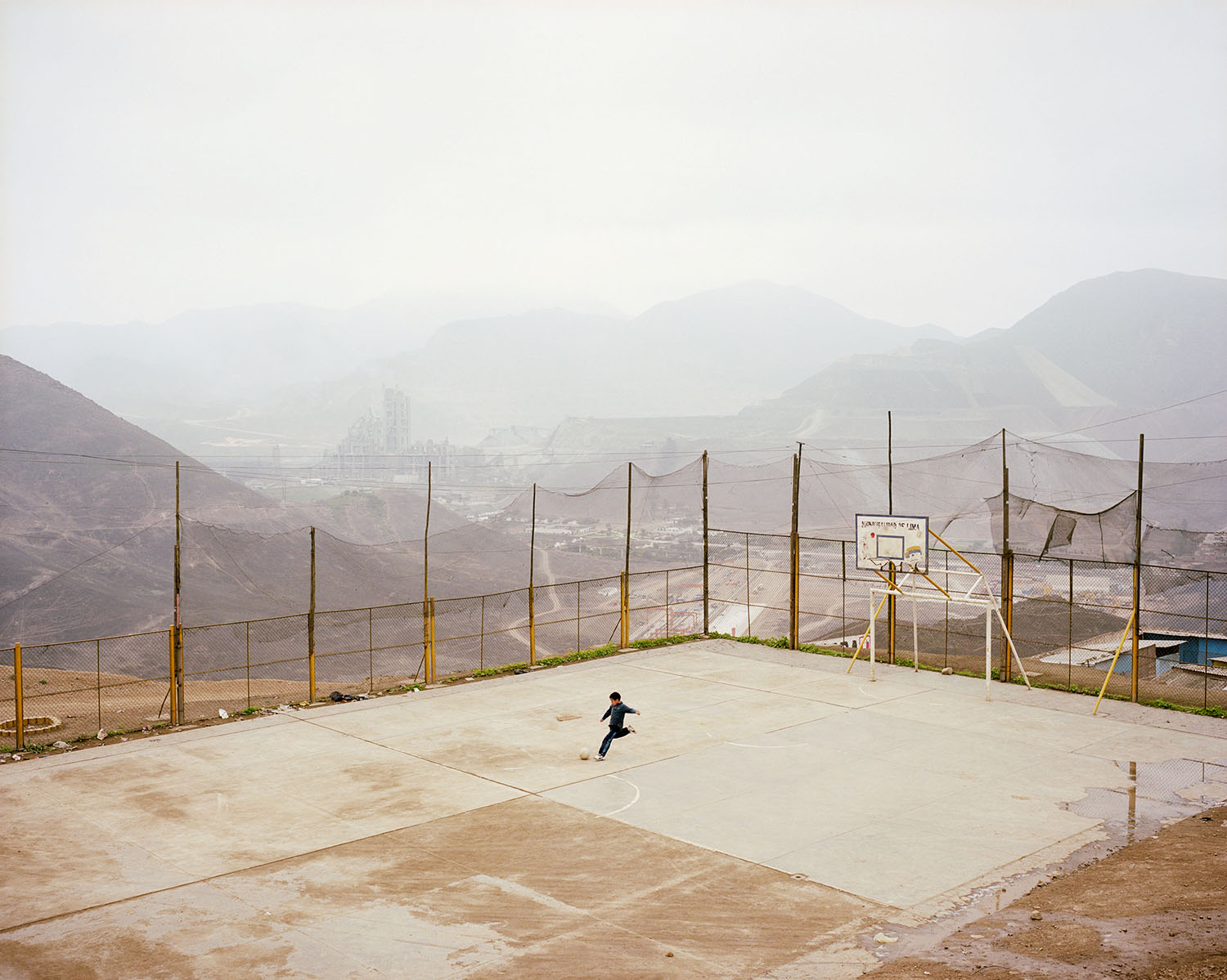 Luis Fernando Vasquez plays futbol in the La Pradera Settlement, Lima. 2010.