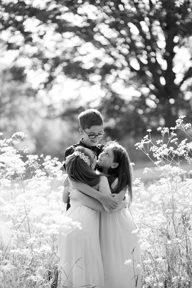 brother hugging his two sisters - chelmsford family photography