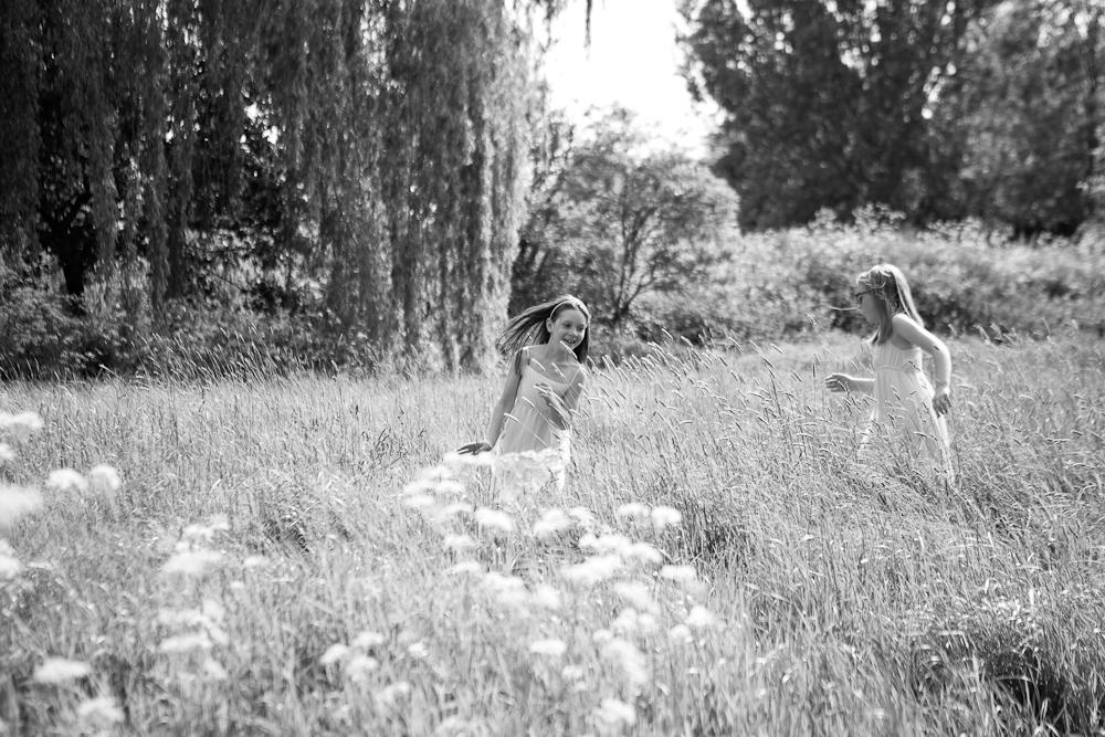 little girl running through field