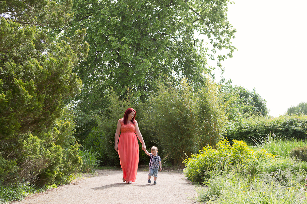 mum and boy walking in park