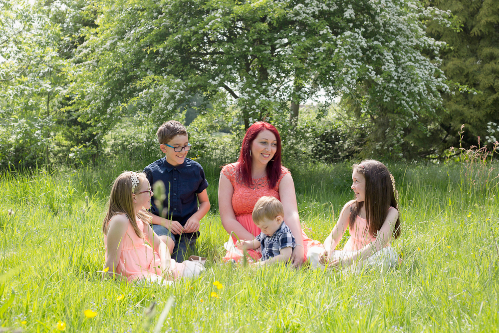 family sitting in park - chelmsford family photography