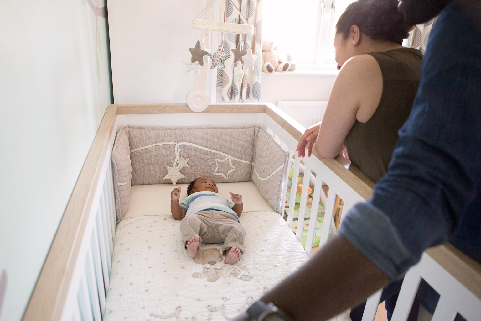 baby boy laying in cot - lifestyle photography at home