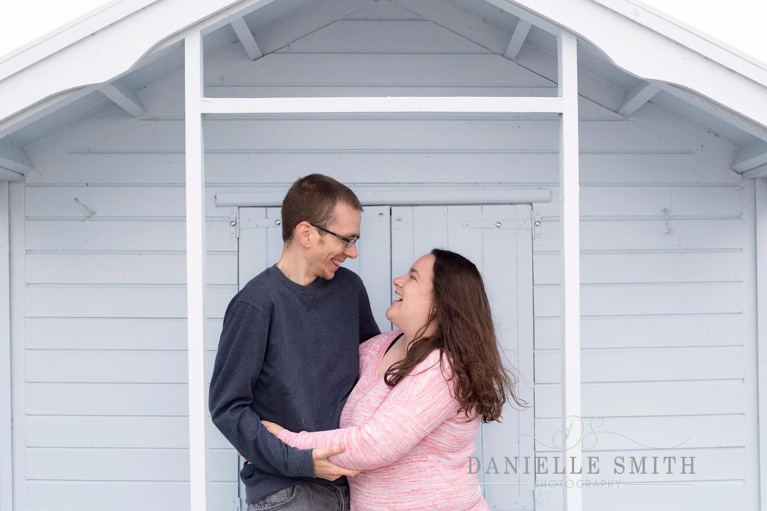 couple laughing - seaside engagement photo shoot