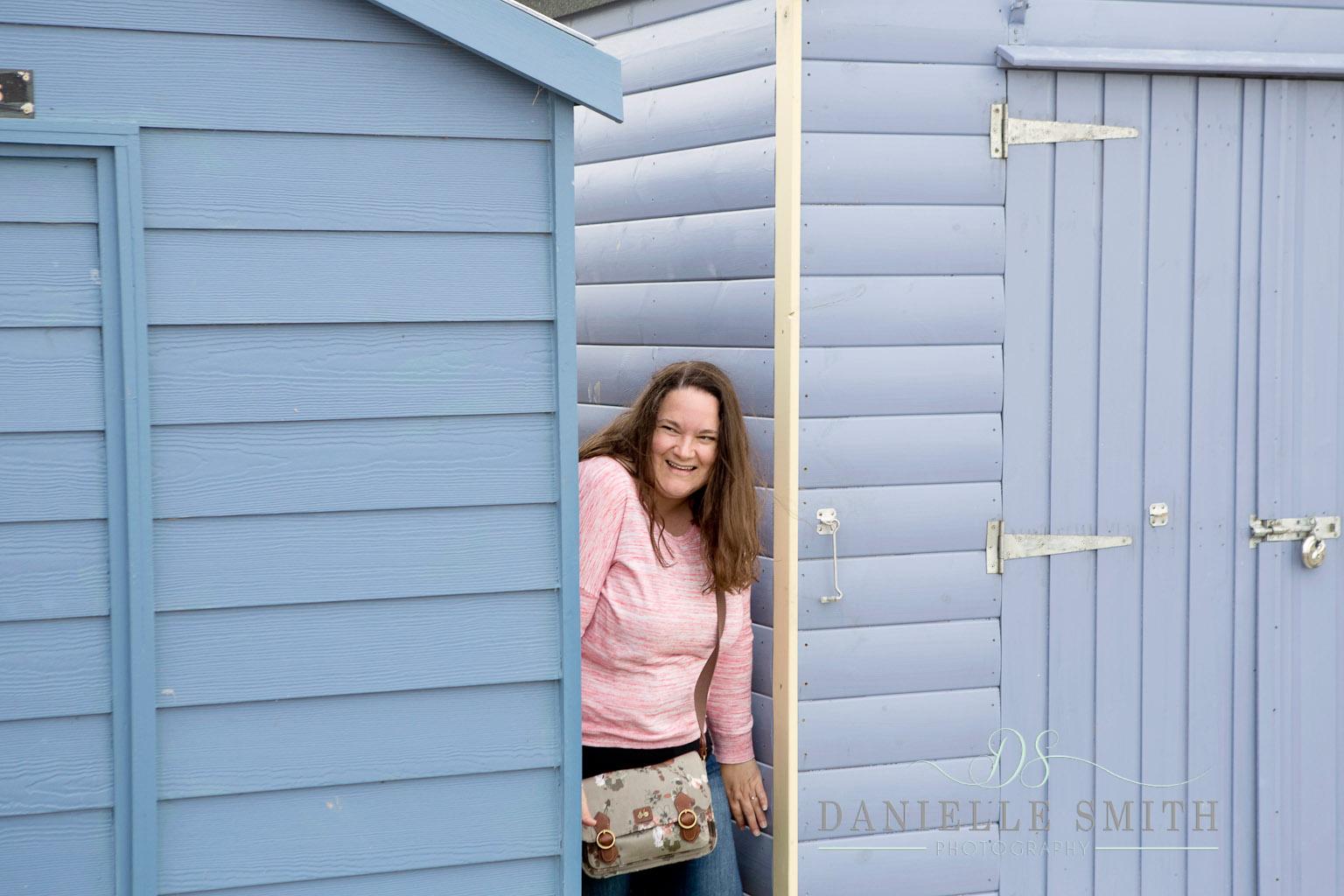 bride to be hiding between beach huts