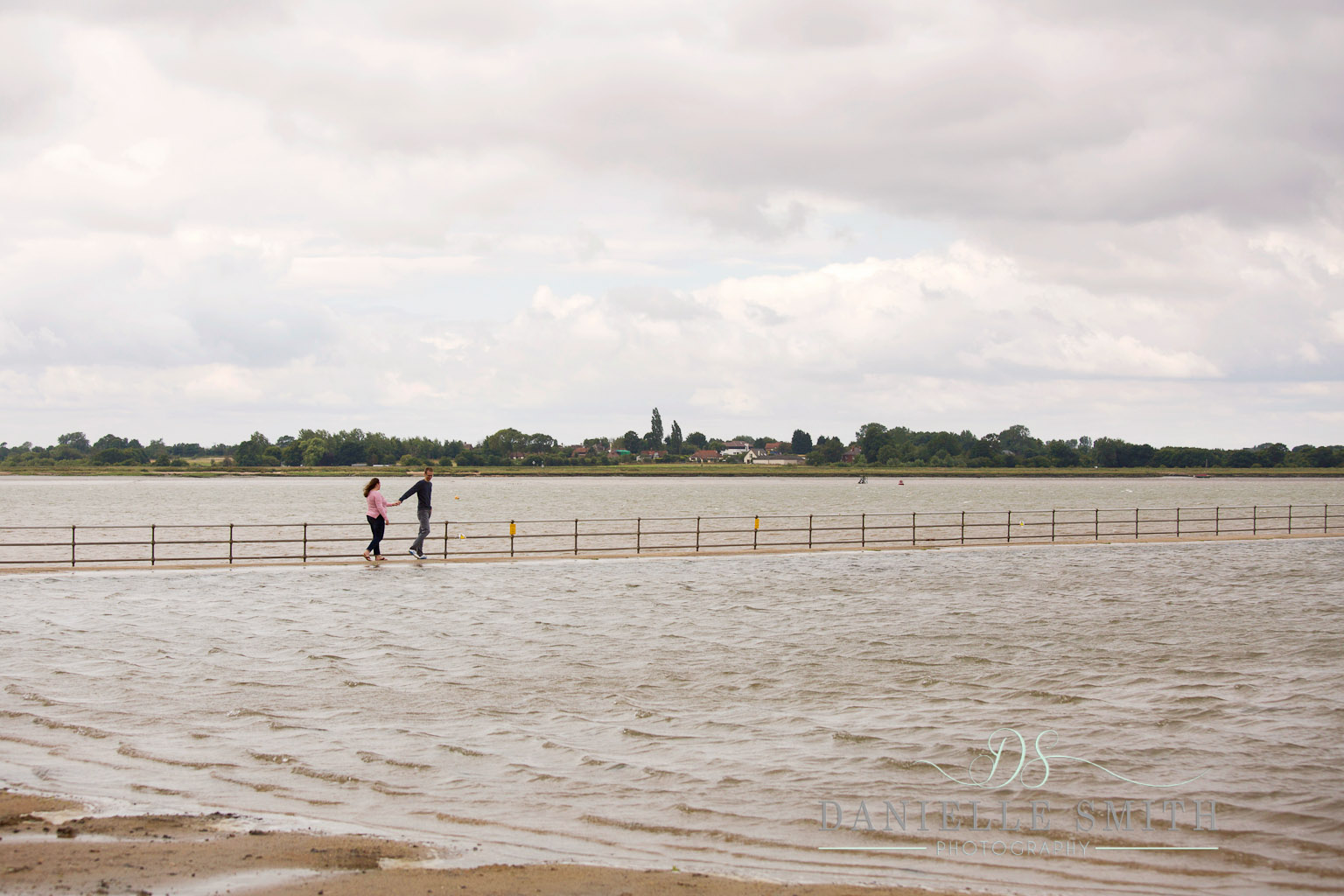 couple walking along by sea