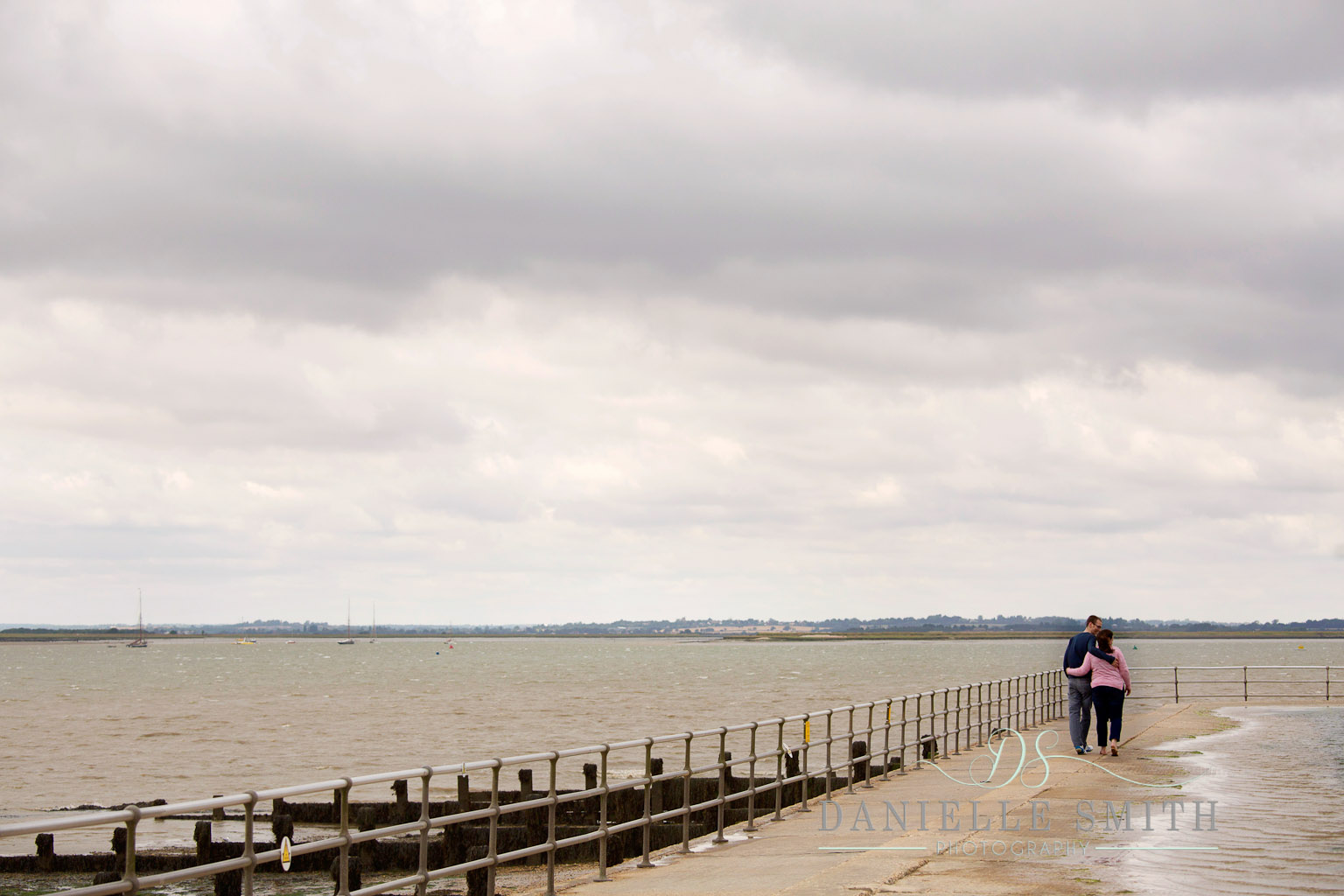 couple walking along by the seaside