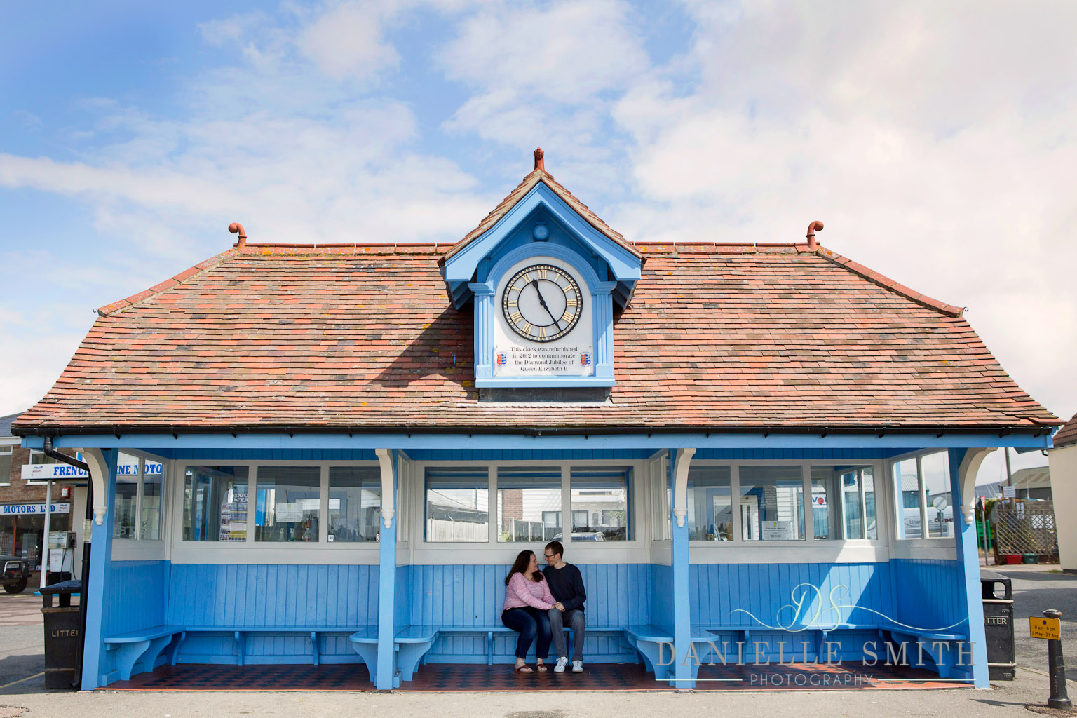 couple in bus shelter at beach town
