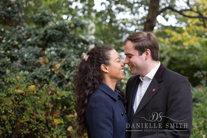 couple nuzzling in autumn engagement session