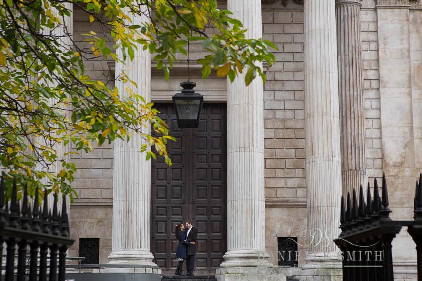 couple standing in front of huge doors at st pauls