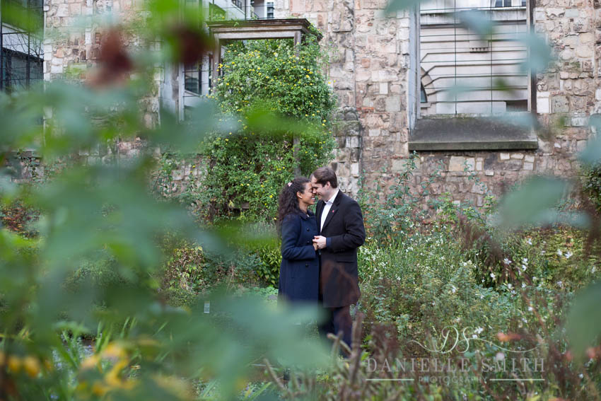 couple nuzzling at engagement photography session london