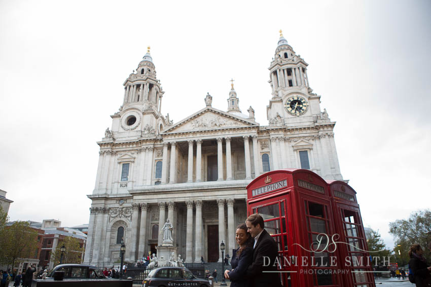 couple in front of st pauls with telephone box