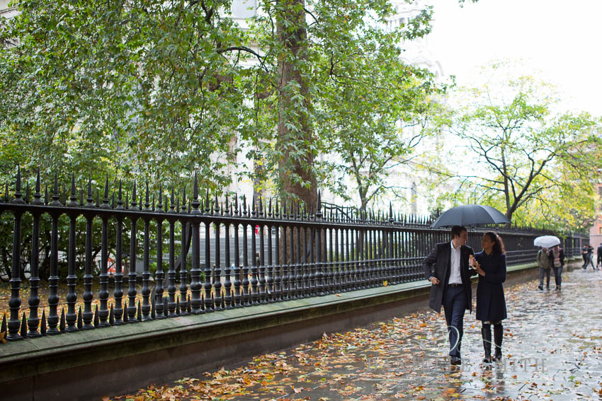 walking walking in rain with umbrella at st pauls