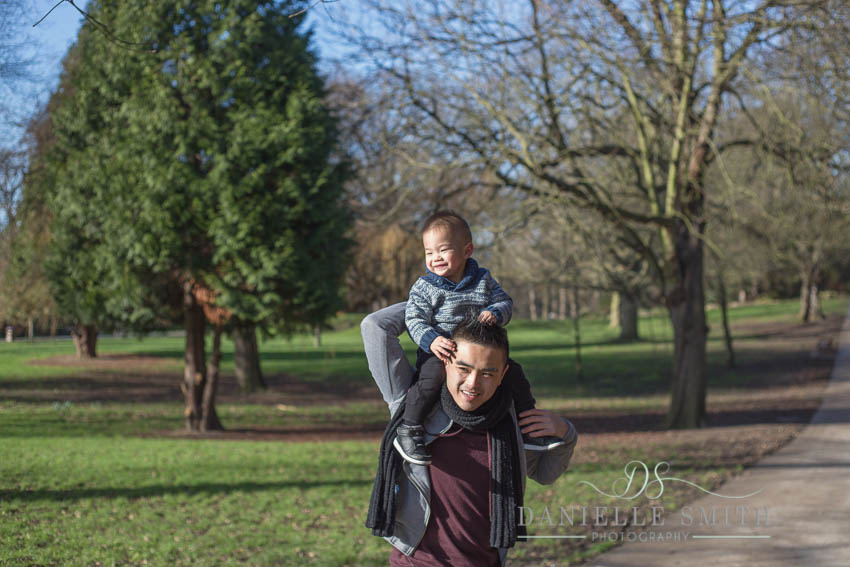 little boy on dads shoulders